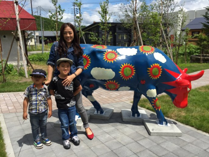 Yuko And Her Sons In Front Of One Of The Niseko Cows