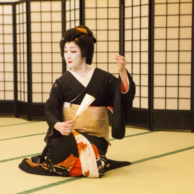 Elegant geisha seated.