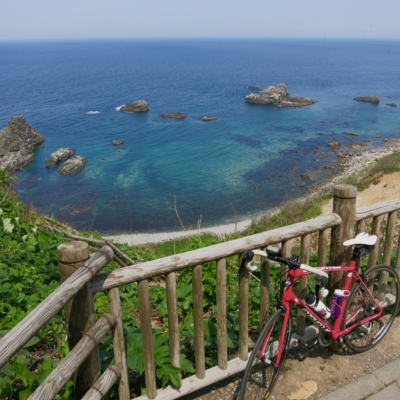 A shot of Phillips' bike with the Shakotan coastline as the backdrop