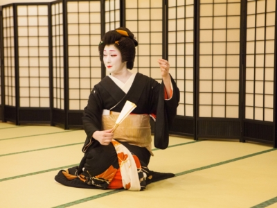 Elegant geisha seated.