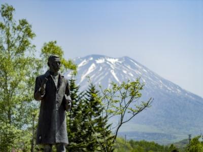 Takeo Arishima Statue At The Arishima Memorial Museum Mt Yotei Background Blue Skies May Spring
