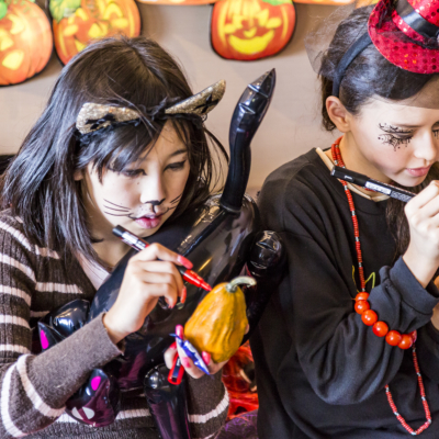 Kids Drawing On Pumpkins At Halloween Event 2016